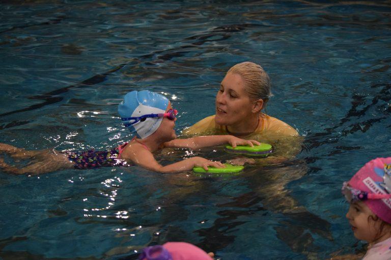 Child in swimming lesson